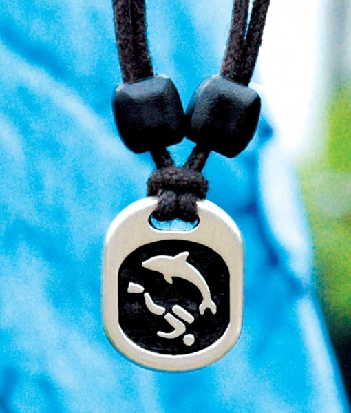 diver with dolphin pendant